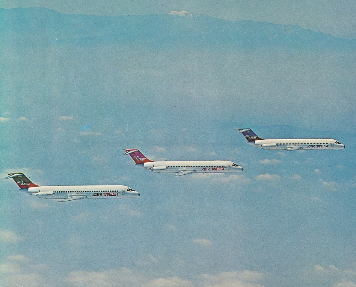 "Back when airlines had money to burn. An airline promotional air to air photo showing the various paint schemes utilized by Hughes Air West during the early 1970s. Aircraft ""N9345"" is on the bottom left in this formation flight. (LostFlights File Photo)"