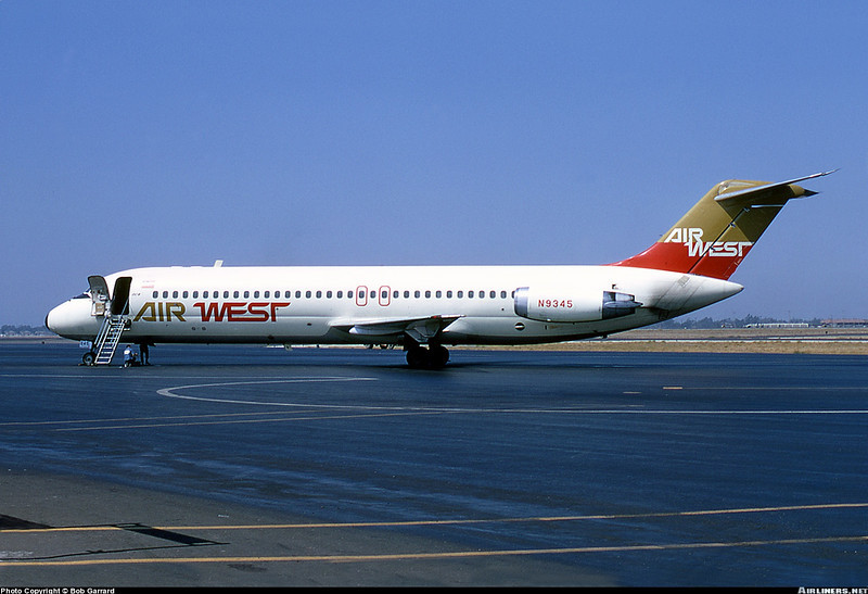 "With less than 11 months remaining, this is one of the last published photos of ""N9345"". This particular shot was taken by Bob Garrard at Santa Ana's John Wayne County Airport (SNA) during the summer of 1970.  <br /> <br /> In early 1969 four color schemes were adopted by Air West utilizing the same basic livery design. They were:  Blue and Mustard; Lime and Blue; Pink and Orange and Mustard and Orange as seen on the DC-9 above. (Bob Garrard Photo Credit)"