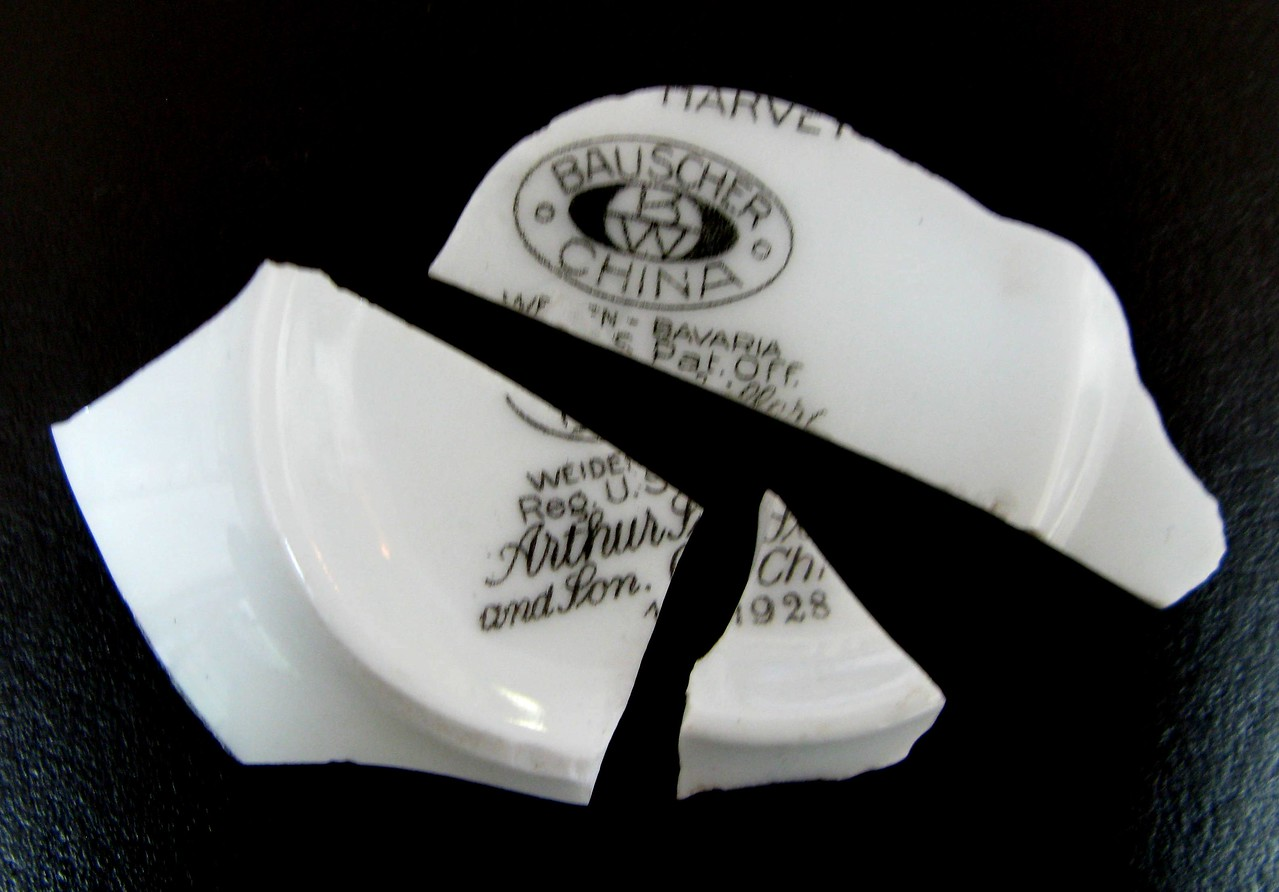 These three fragments of Bauscher Bavarian China were recovered at the site by a previous project team. The china was used by T.A.T. to serve meals to passengers. <br /> <br /> Dated 1928, this serviceware was provided to T.A.T. by the Fred Harvey Company who also provided the same serviceware to the railroads.