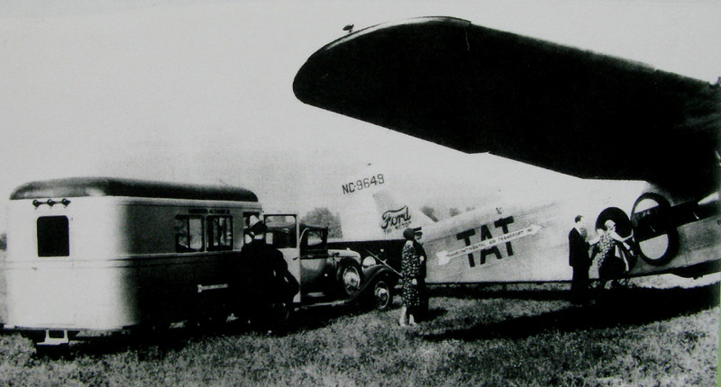 "In the morning, motor coaches would deliver the air/rail passengers to the airport where they would board one of T.A.T.'s Ford Tri-Motor aircraft. <br /> <br /> During the day, passengers would travel by air nearly 800 miles. The evenings would be spent traveling by railway Pullman cars.<br /> <br /> In this photo, passengers are seen leaving the T.A.T. Motor Coach and boarding the ""City of San Francisco""."