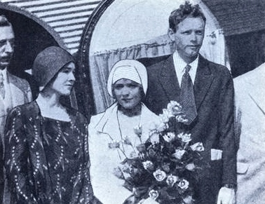 Promoting T.A.T.'s new transcontinental Tri-Motor service was a full time job for Charles Lindbergh shown in Los Angeles with Mrs. Lindbergh and legendary screen actress Mary Pickford.