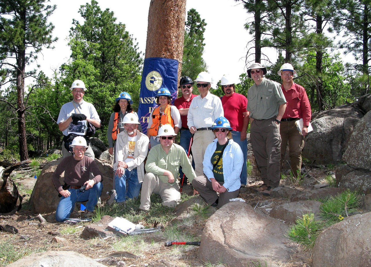 "THE 2009 ""PASSPORTS IN TIME"" TEAM:<br /> <br /> In June of 2009, the USFS assembled a group of volunteers from both the conventional and aviation archaeology communities to survey, excavate, and document the 1929 crash site of T.A.T. Flight A19. <br /> <br /> Pictured in the back row from left to right are: Dan Deloria, Linda Popelish (USFS), Cristin Embree (USFS), Brian Richardson, Bob Rushforth, Cliff Nikall (USFS), Mike McComb, and Matt Wehling. Pictured front row from left to right are: Steve Owen, Dick Cochran, Craig Fuller, and Erin Brown (USFS)."