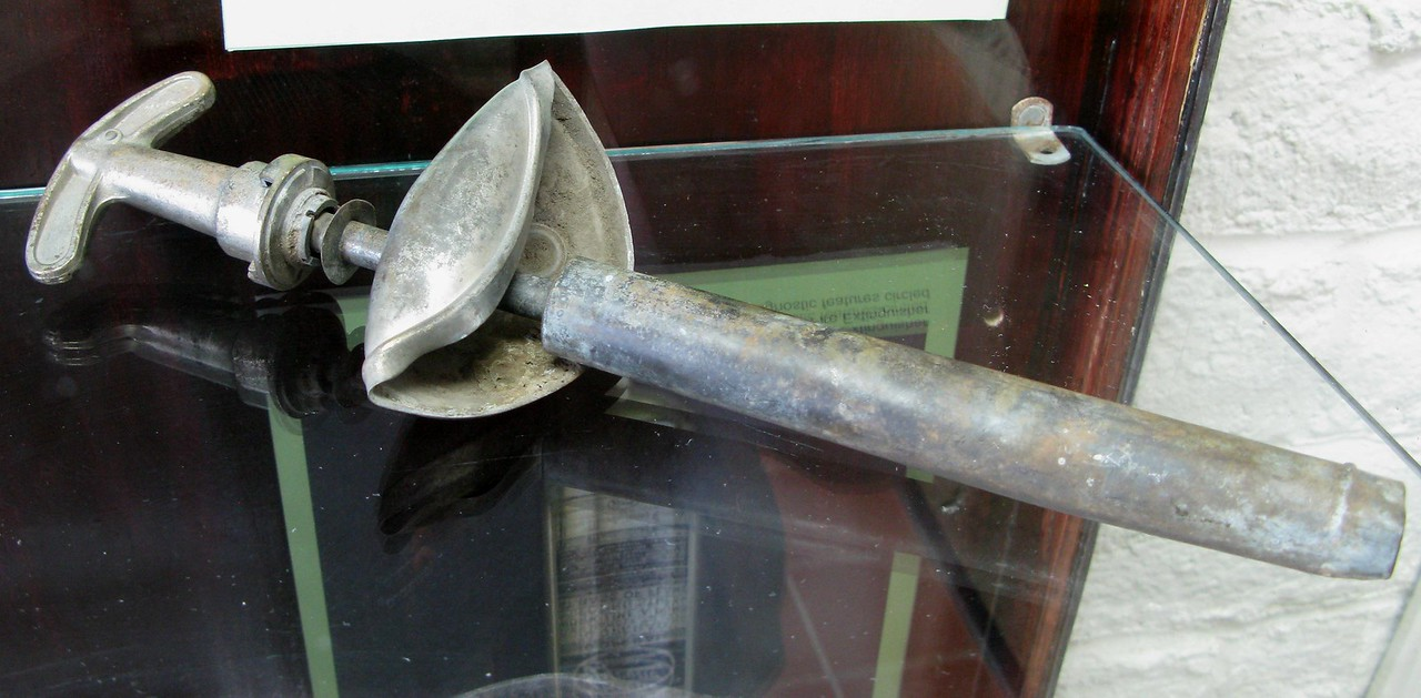 "This Pyrene fire extinguisher handle and pump assembly was recovered from the crash site of the ""City of San Francisco"" by a local resident. It is currently on display at the USFS District Office in Grants."