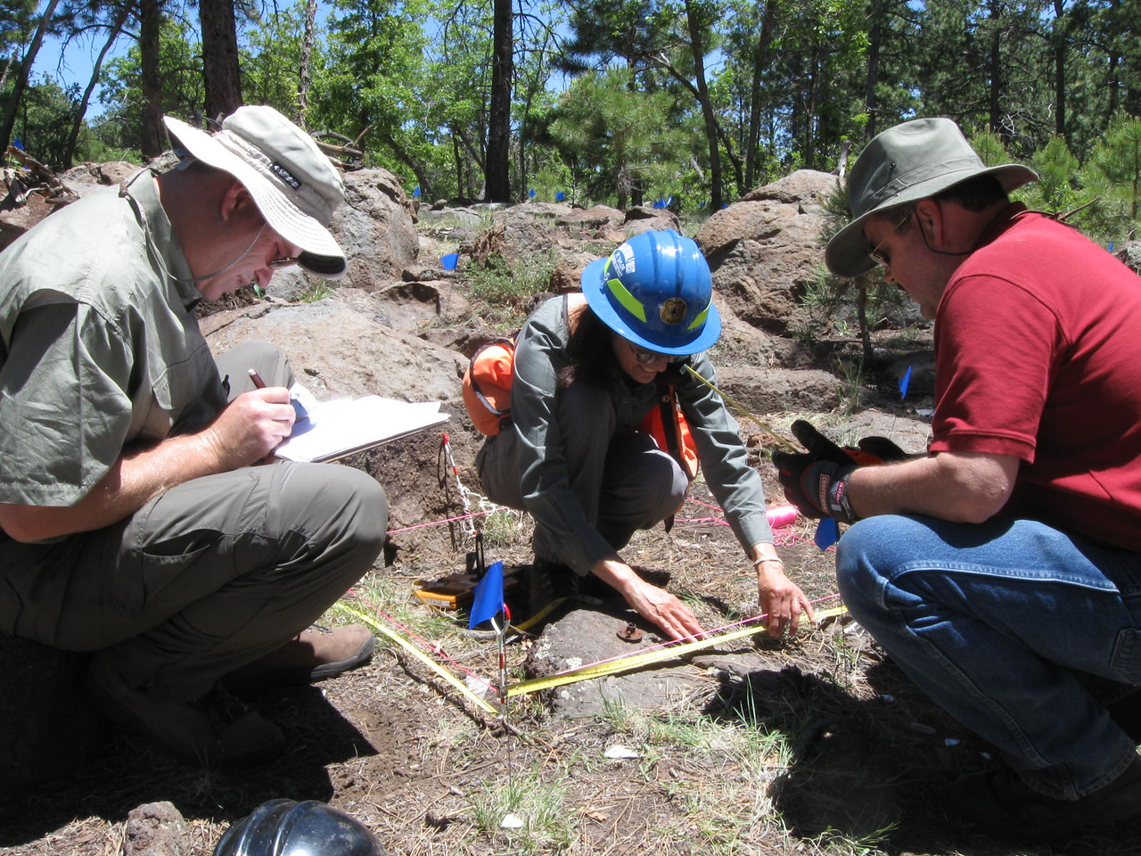 Mike McComb, Linda Popelish, and Brian Richardson begin the excavation work as surface features are mapped first prior to any digging.