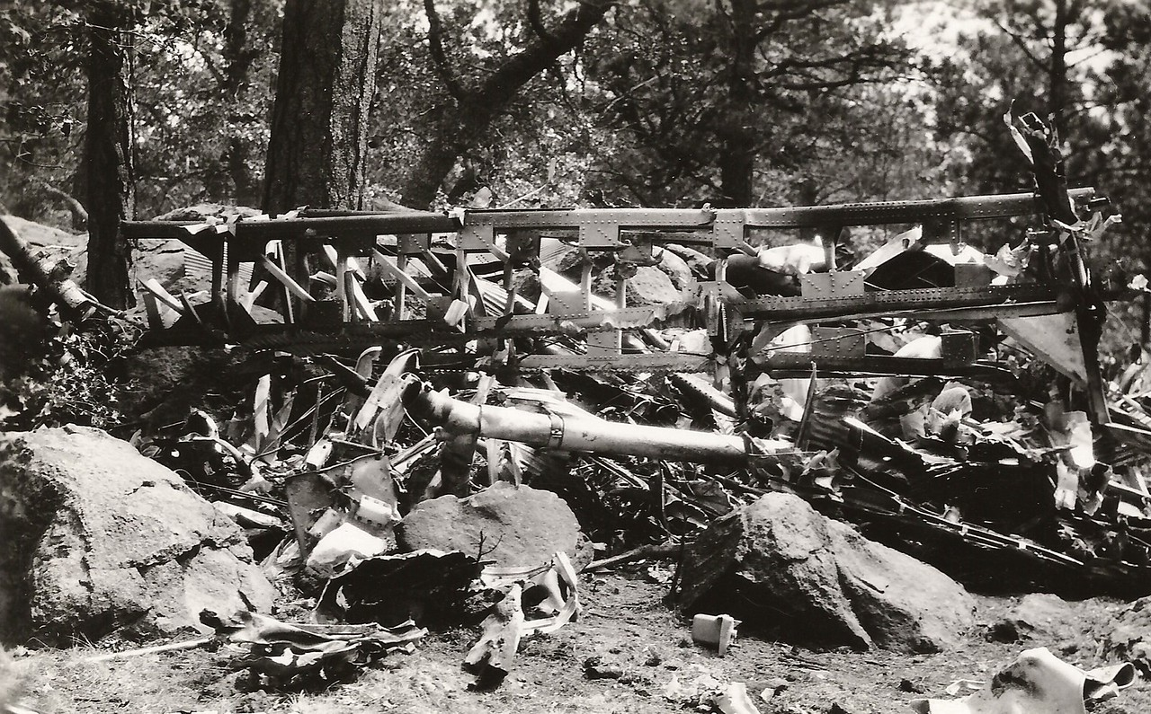 1929 - This photo depicts the wing spar support as it rests on a pile of burned cabin debris. (J.R. Willis Photo)