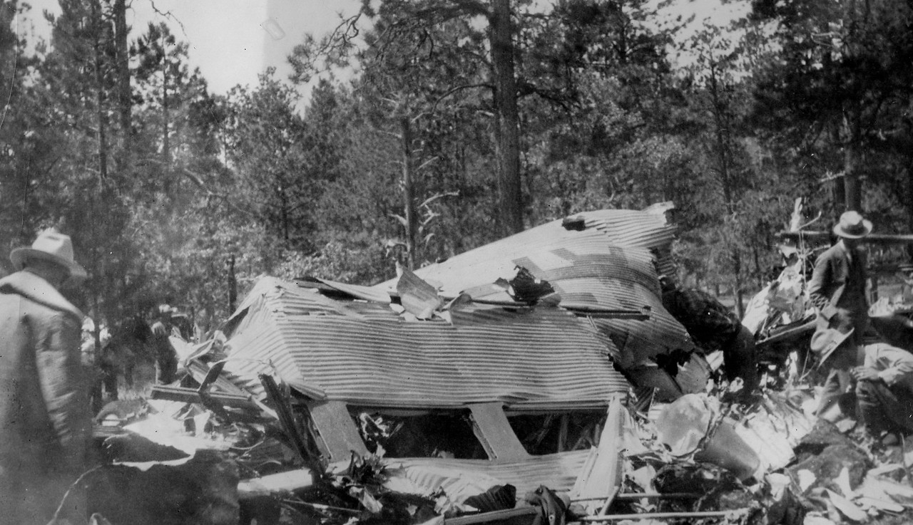 Local ranchers and lumber men were the first to arrive at the accident site. (J.R. Willis Photo)