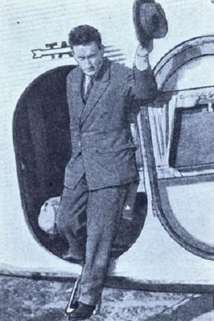 """1929 - Richard A. Burke stepping off a T.A.T. Ford Tri-Motor after completing a record breaking trip from London to Los Angeles in """"only"""" 148 hours, 19 minutes. Mr. Burke's Trans-Atlantic portion of his trip was made via the Graf Zeppelin airship."""