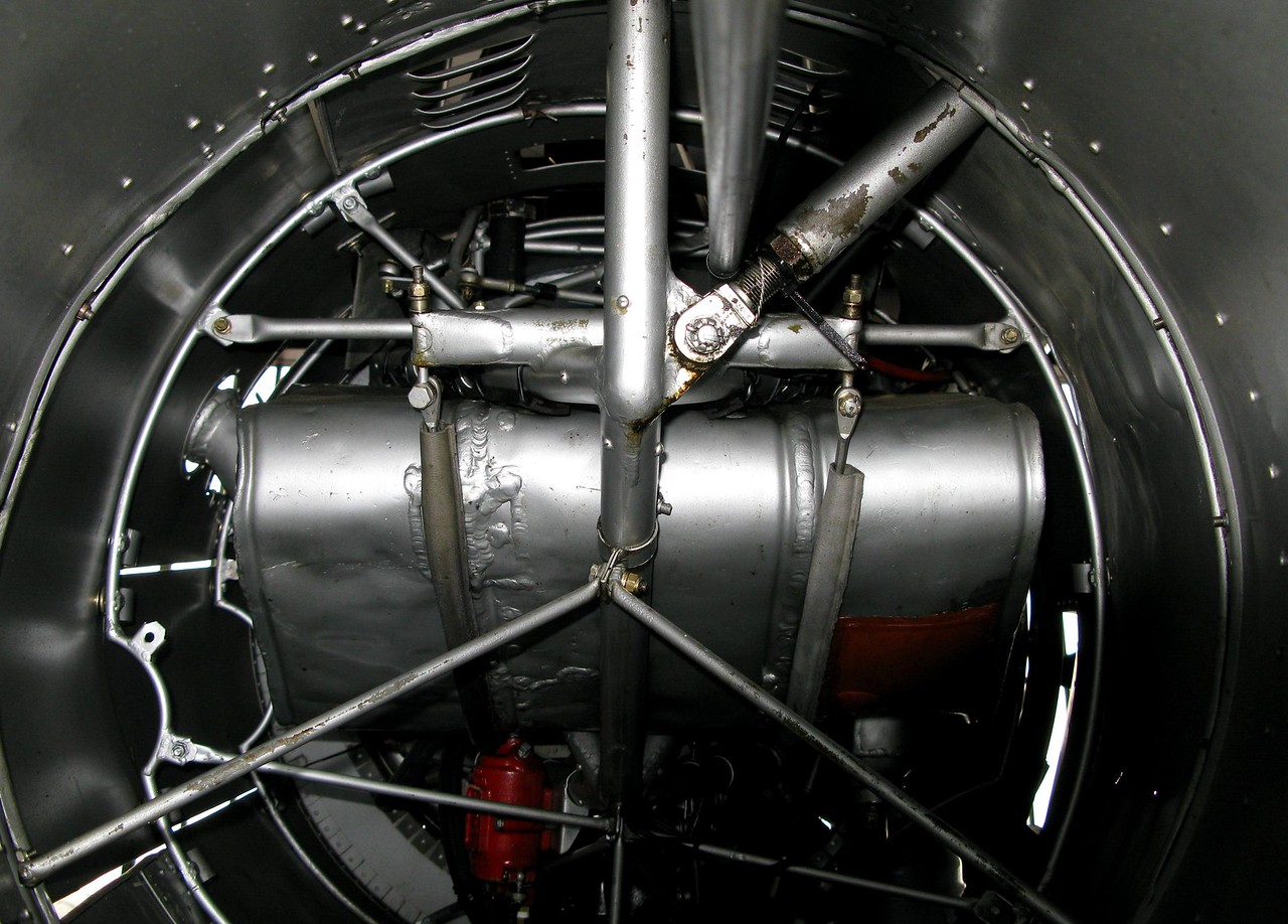 A view inside one of the outer engine nacelles of Ford TriMotor (N414H) provides a look at how the engine cowl supports were used.