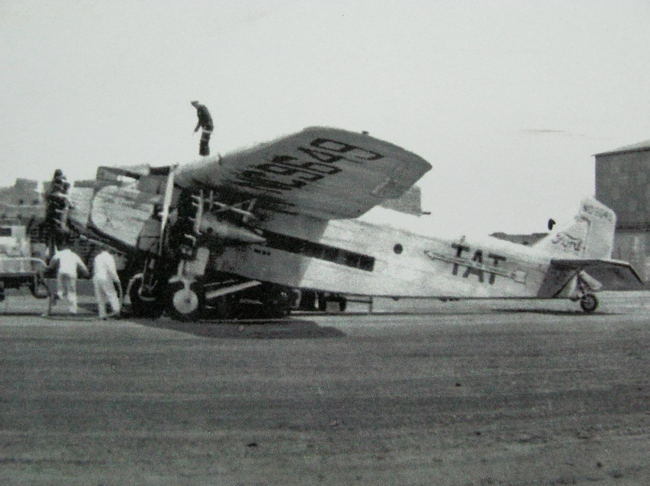 "The ""City of San Francisco"" (NC9649), seen during a fueling stop in Winslow, Arizona in June of 1929. <br /> <br /> The Ford 5-AT-B Tri-Motor was built during 1928 and was the 19th Ford Tri-Motor delivered to Transcontinental Air Transport."