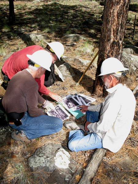 HISTORICAL PHOTO COMPARISON STUDY:<br /> <br /> Matt Wehling, Steve Owen, and Dick Cochran examine copies of the original 1929 J.R. Willis accident site photos as they attempt to compare them with current features and landmarks.