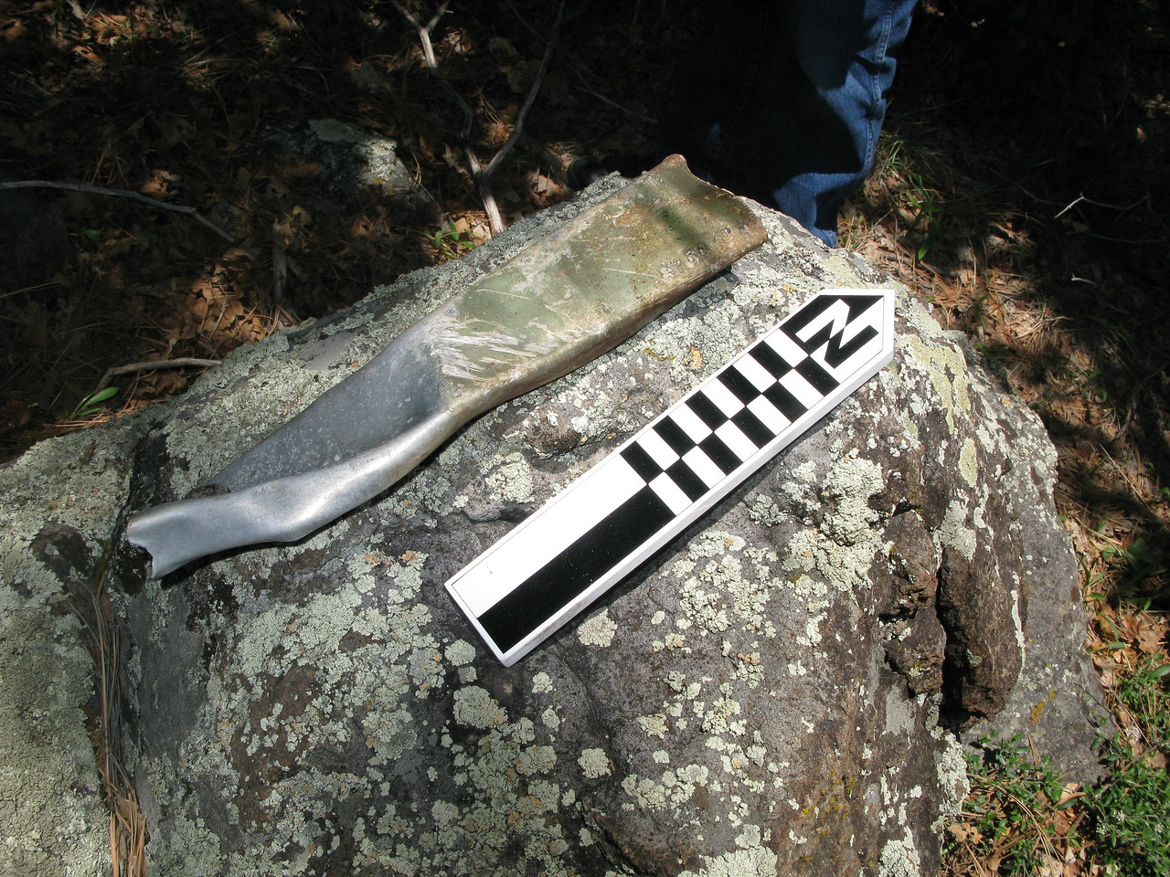 The use of a metal detector helped locate this partially buried fuselage stringer support.