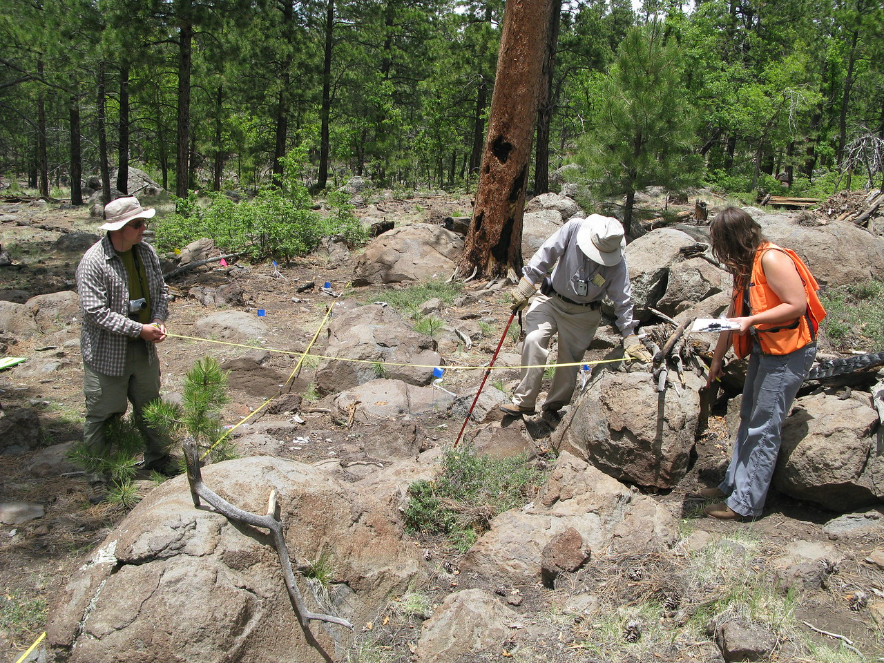 Craig Fuller, Bob Rushforth, and Cristin Embree set up a datum line just prior to the mapping process.