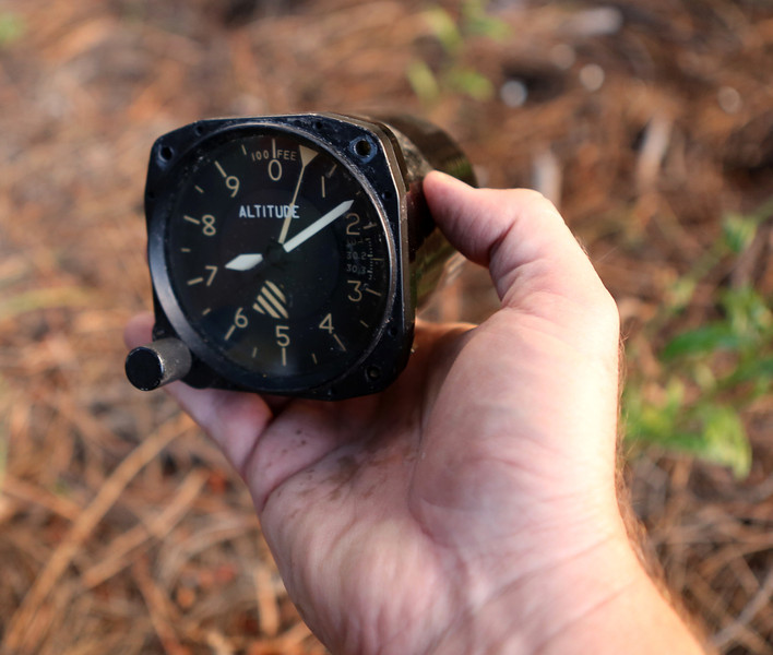 During my initial visit to accident site, I was very surprised that this barometric pressure altimeter was discarded at the site. Externally, there was little visible damage.