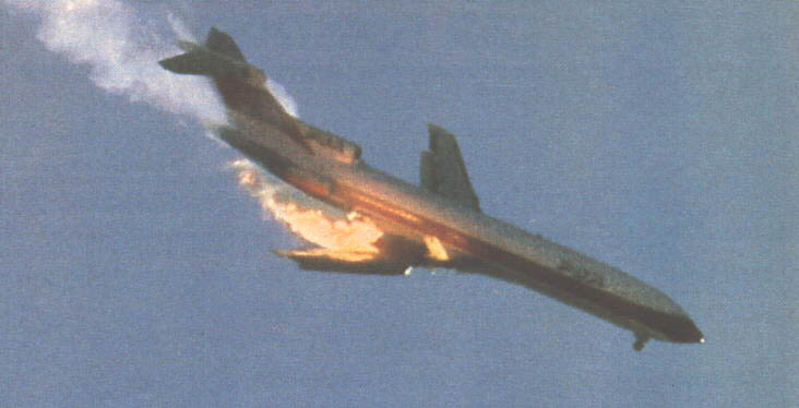 This close-up of Wendt's first photograph shows both the left aileron and elevator fully extended upward as the flight crew attempts to counteract the induced right roll from the damaged wing.