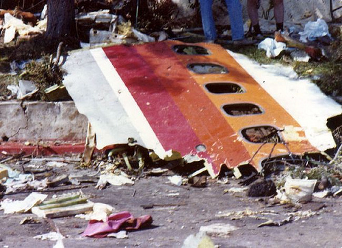 A section of fuselage from the Boeing 727 lies amid other debris. A crushed fragment of the Cessna's fuel tank was found at the impact site of the Boeing 727.