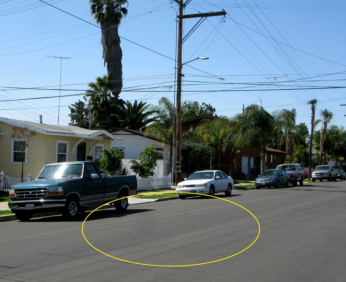 Matching the above historical photo with existing landmarks, I was able to determine the exact location where the main fuselage of the Cessna impacted on Polk Avenue.