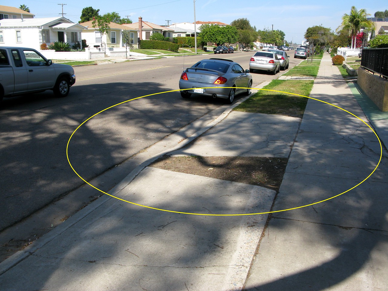 The initial impact point of Flight 182 occurred on this section of sidewalk, driveway, and Nile Street circled in yellow.<br /> <br /> The residence to the right of this photo was unscathed, but everything left of this photo was decimated with wreckage and burning jet fuel that radiated for several hundred feet.