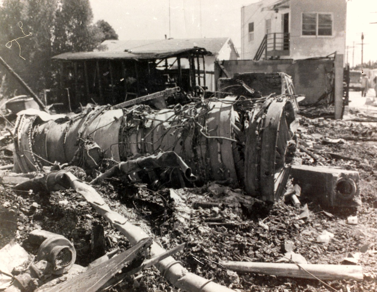 One of three Pratt & Whitney JT8D-7B jet engines lies on a burned foundation at the crash site of the Boeing 727.