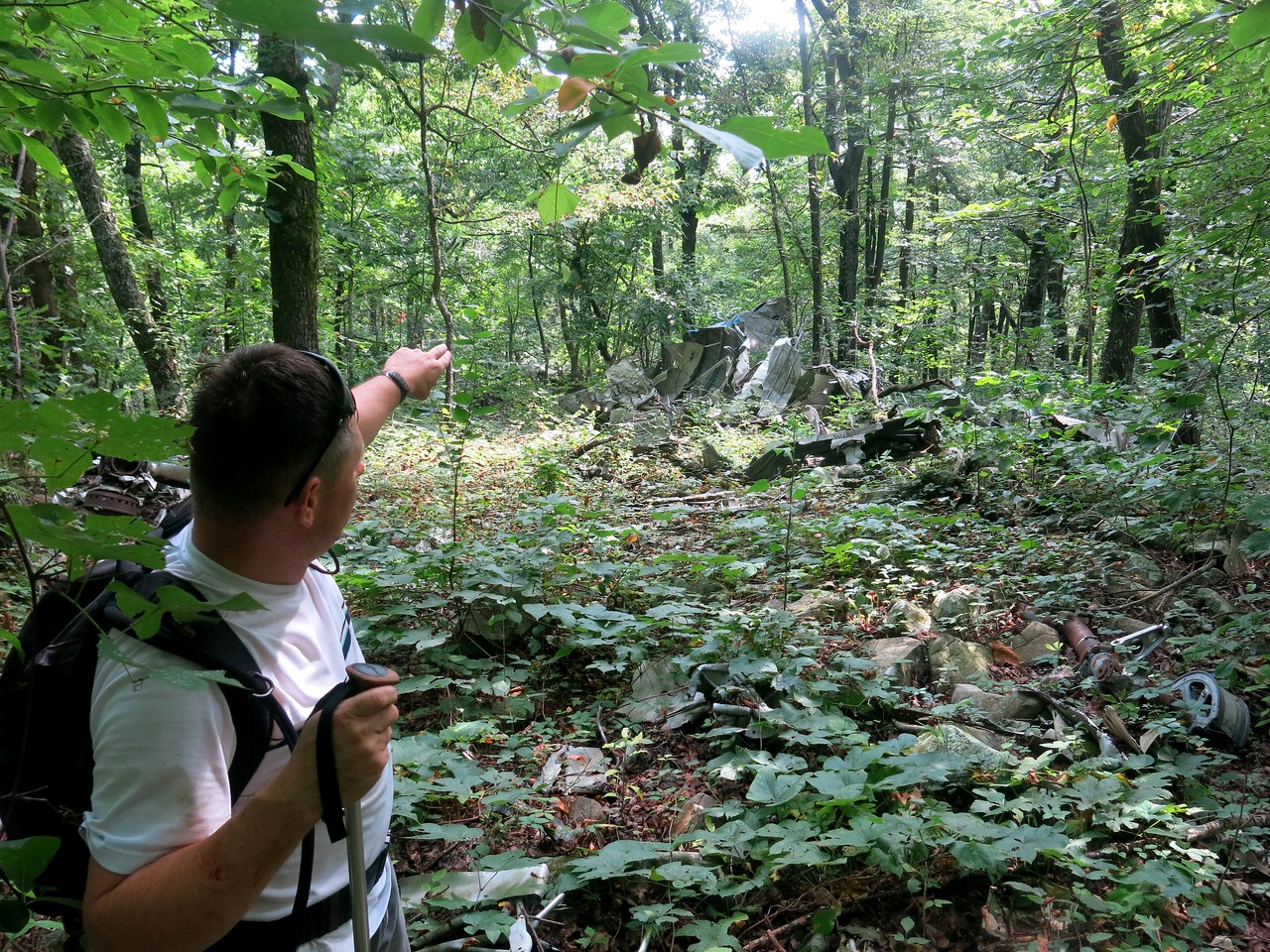 Jeff Wilkinson points to the main concentration of wreckage debris from Flight 655.