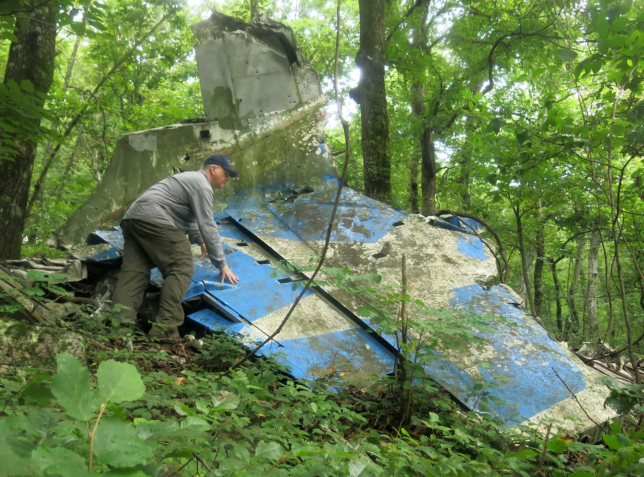 The largest single piece of wreckage remaining at the crash site of Flight 655 was the tail section. <br /> <br /> An examination of the Convair's vertical stabilizer and rudder revealed several opened inspection panels. After many years on the mountain the airline's star logo has not faded.