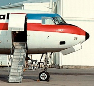 This photo captures a view of the main passenger boarding door and fold down stairs on a Texas International Convair 600.