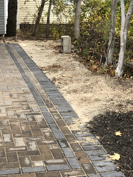 No landscaping yet on right of driveway...
