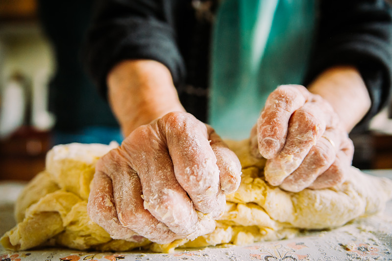 close up of old  italian lady's hands making home made italian pasta