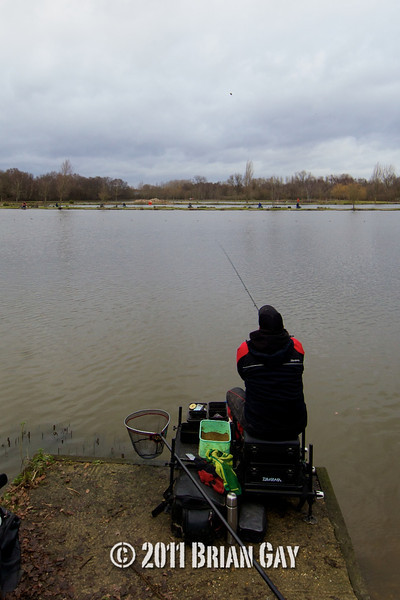 casting action, Will Raison fishes a small cage feeder with dead maggots and fishmeal for bream. © 2012 Brian Gay