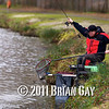 Rod bends into a skimmer bream, Will Raison fishes a small cage feeder with dead maggots and fishmeal for bream. © 2012 Brian Gay