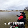 Casting Will Raison fishes a small cage feeder with dead maggots and fishmeal for bream. © 2012 Brian Gay