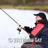 line hits the clip on the reel while casting, Will Raison fishes a small cage feeder with dead maggots and fishmeal for bream. © 2012 Brian Gay