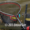 Landing net head, Will Raison fishes a small cage feeder with dead maggots and fishmeal for bream. © 2012 Brian Gay