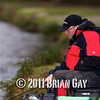 Holding the rod ready to strike fast bites. Will Raison fishes a small cage feeder with dead maggots and fishmeal for bream. © 2012 Brian Gay