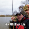 Holding the filled loaded feeder, Will Raison fishes a small cage feeder with dead maggots and fishmeal for bream. © 2012 Brian Gay