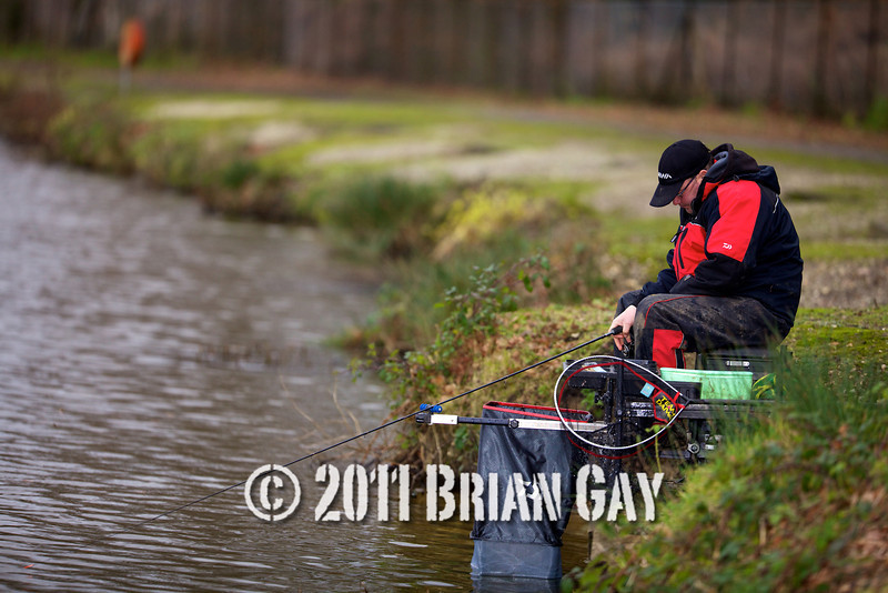 Waiting for the line to sink after casting, Will Raison fishes a small cage feeder with dead maggots and fishmeal for bream. © 2012 Brian Gay