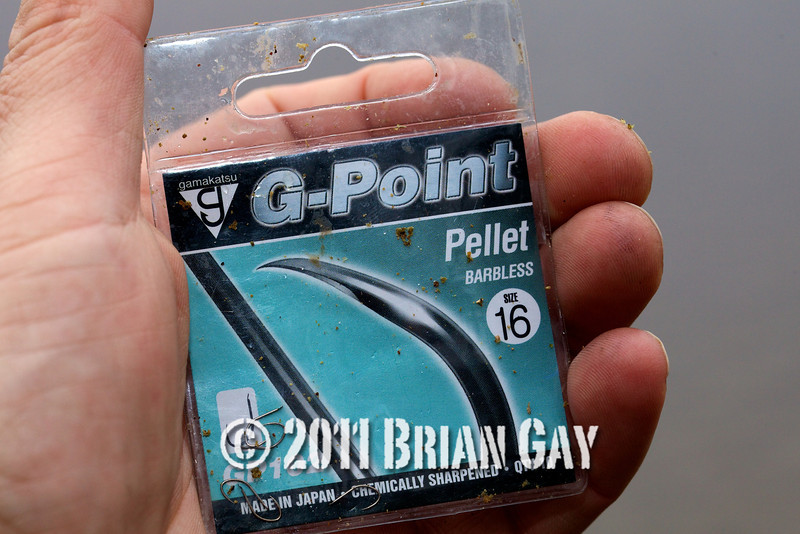 packet of Gama G-Point Pellet Barbless size 16 hooks. Will Raison fishes a small cage feeder with dead maggots and fishmeal for bream. © 2012 Brian Gay