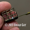 Detail - Drennan 10 gr. micro cage feeder, Will Raison fishes a small cage feeder with dead maggots and fishmeal for bream. © 2012 Brian Gay