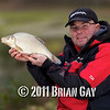 Will Raison fishes a small cage feeder with dead maggots and fishmeal for bream. © 2012 Brian Gay