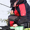filling the feeder, Will Raison fishes a small cage feeder with dead maggots and fishmeal for bream. © 2012 Brian Gay