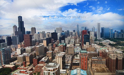 Aerial shot of Chicago, featuring Willis Tower (formerly the Sears Tower), Trump Tower, Aon Center, Harold Washington Library, University Center, CNA building, Prudential building, the Red Line and the John Hancock building.