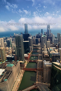 An aerial photo of downtown Chicago facing east over the Chicago River. In this photo, the Merchandise Mart, Marina Towers, Trump Tower, Aon Center and Lake Michigan.