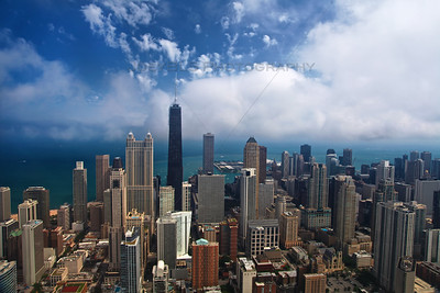 An aerial photo of downtown Chicago facing east over the Chicago River. In this photo, the John Hancock, Water Tower Place and Lake Michigan.