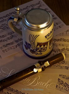 Baroque Flute and beer stein on music (Bach).