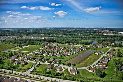 Aerial photo of the Stone Bridge Estates subdivision in Schererville, Indiana. Stone Bridge Estates has premium homes built by Precision Construction, a Northwest Indiana new home builder.