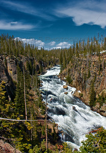 The Lewis River flows through Yellowstone National Park in Wyoming.