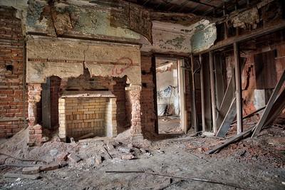 Broken Fireplace in an Empty Room