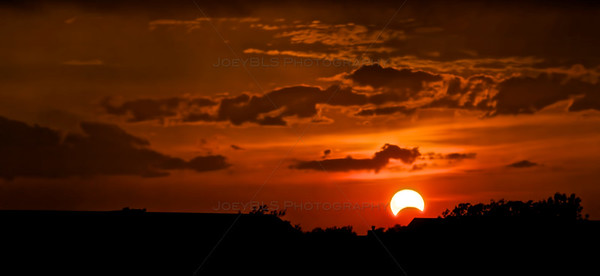 "A solar eclipse taking place in Schererville, Indiana on May 20, 2012. This is the first solar eclipse with a ""ring of fire"" in 18 years, however, only a small amount of people in the western United States were able to see the moon completely eclipsing the sun."