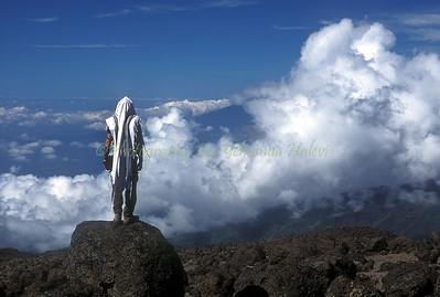 Morning prayers at 14,000 feet above sea level, Western Breach, Mt. Kilimanjaro, Tanzania, Africa.