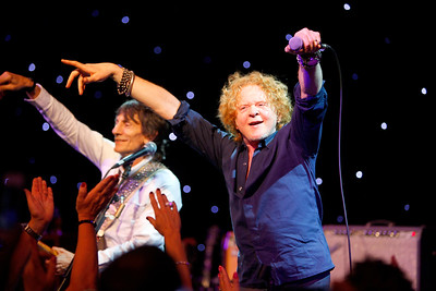 Ronnie Wood and Friends gig at Jimmy White Testimonial. Ronnie Wood pictured on stage with Mick Hucknall.