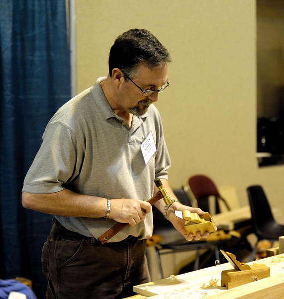 Dan Barrett of D.L. Barrett and Sons  adjusting a bullnose plane. Dan is not only a master planemaker, but also a master carpenter. He's also a master smart-, well, uh, you get the gist. Dan was kind enough to bring me an adjusting hammer that his son Kyle made from some incredible bird's eye maple.